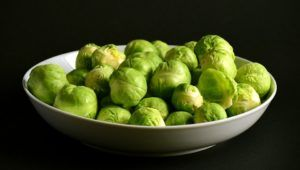 He doesn't eat Brussels sprouts (a bowl of Brussels sprouts)